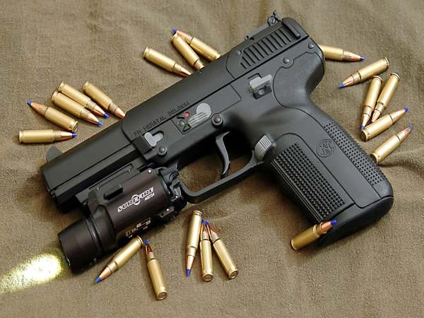 nằm mơ thấy súng